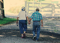 Image of Elderly Couple Walking and Holding Hands