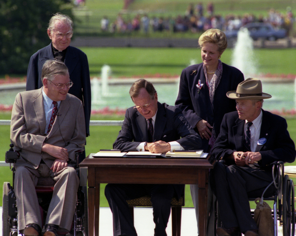 Image of George Bush Sr. signing the ADA into law