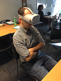 Image of Sam with Dementia Virtual Reality goggles